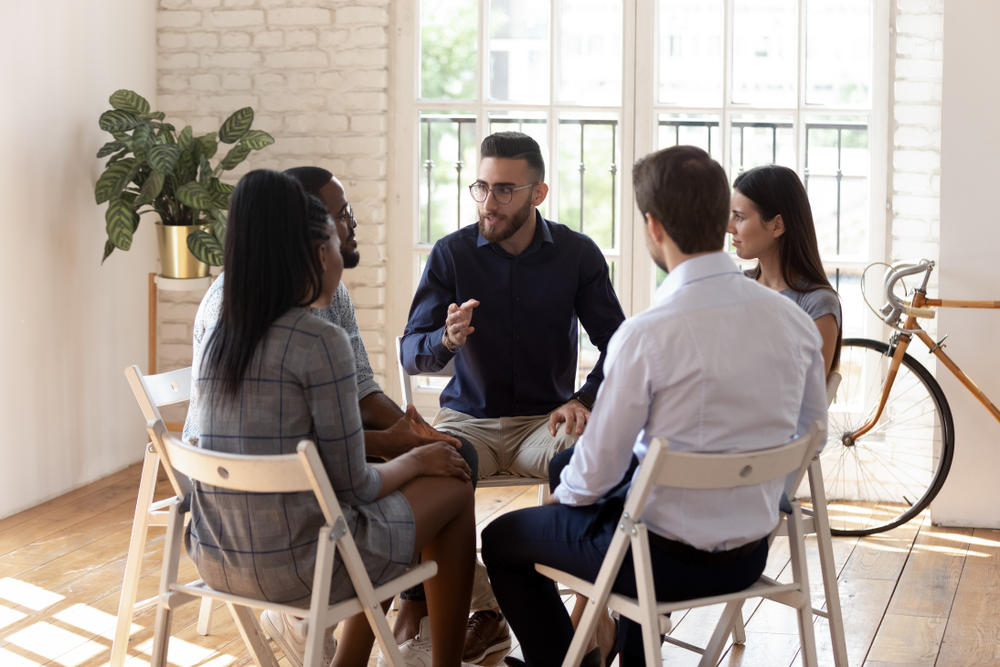 Male,Psychologist,Counselor,Therapist,Coach,Speak,At,Group,Therapy,Session