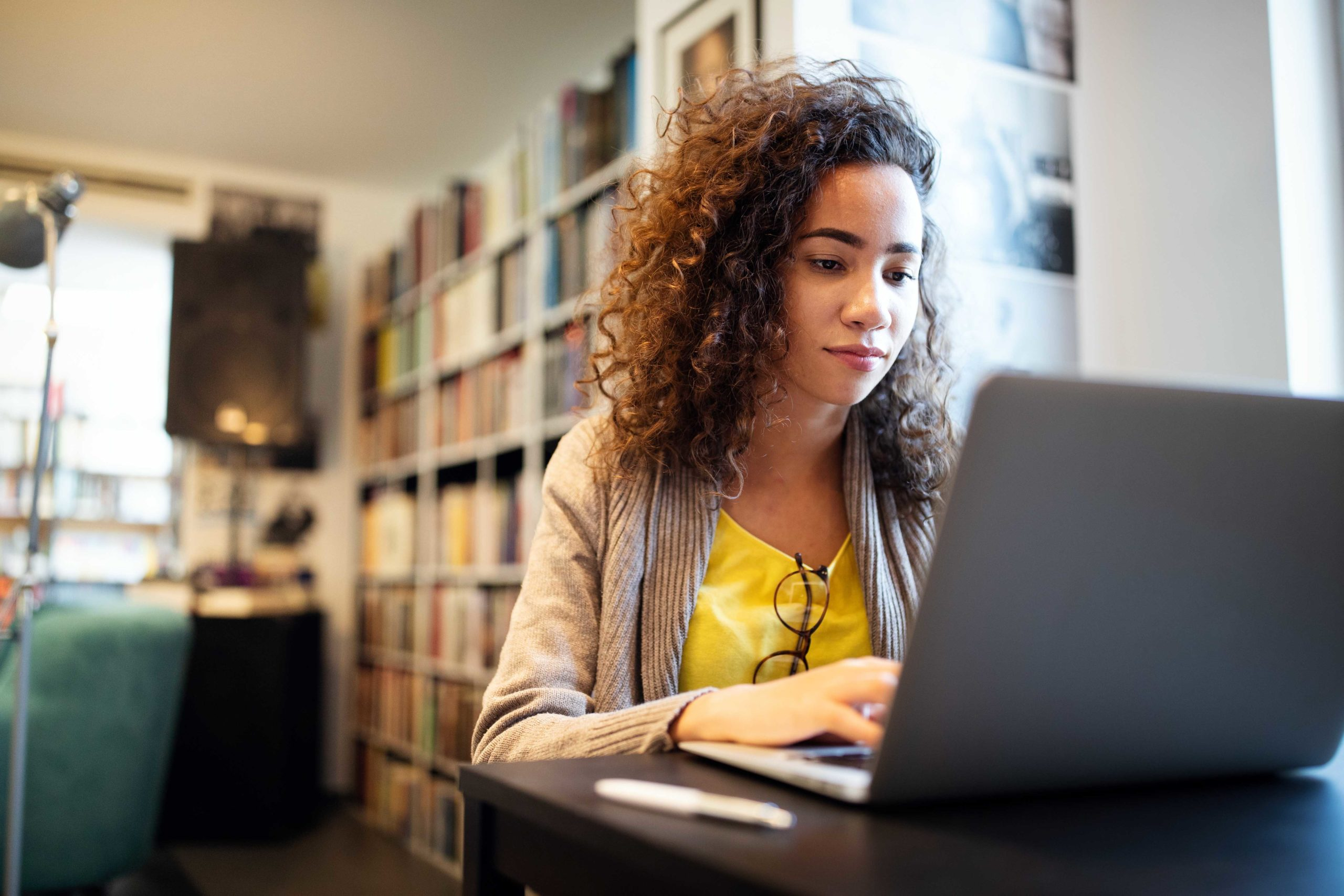 Young,Beautiful,Student,Girl,Working,,Learning,In,College,Library