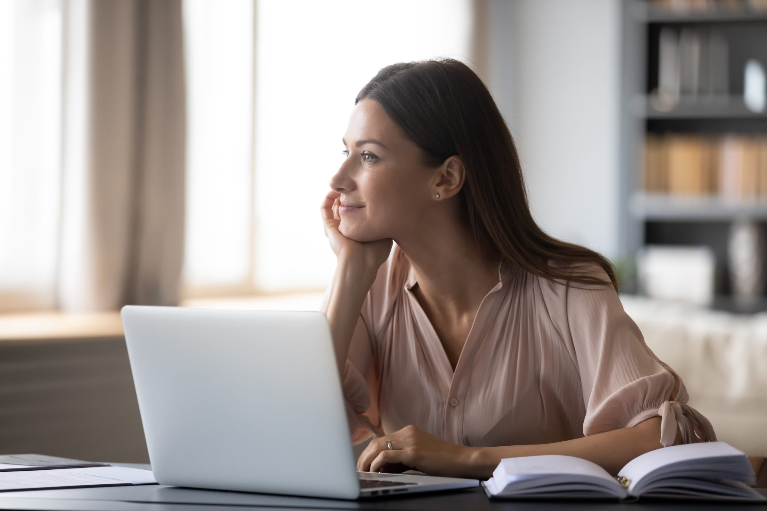 Dreamy,Young,Woman,Pondering,Ideas,,Sitting,At,Desk,With,Laptop,