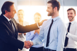 Great,Job!,Two,Cheerful,Business,Men,Shaking,Hands,While,Their