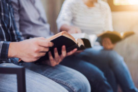 Christian,Friends,Group,Reading,And,Study,Bible,Together,In,Home