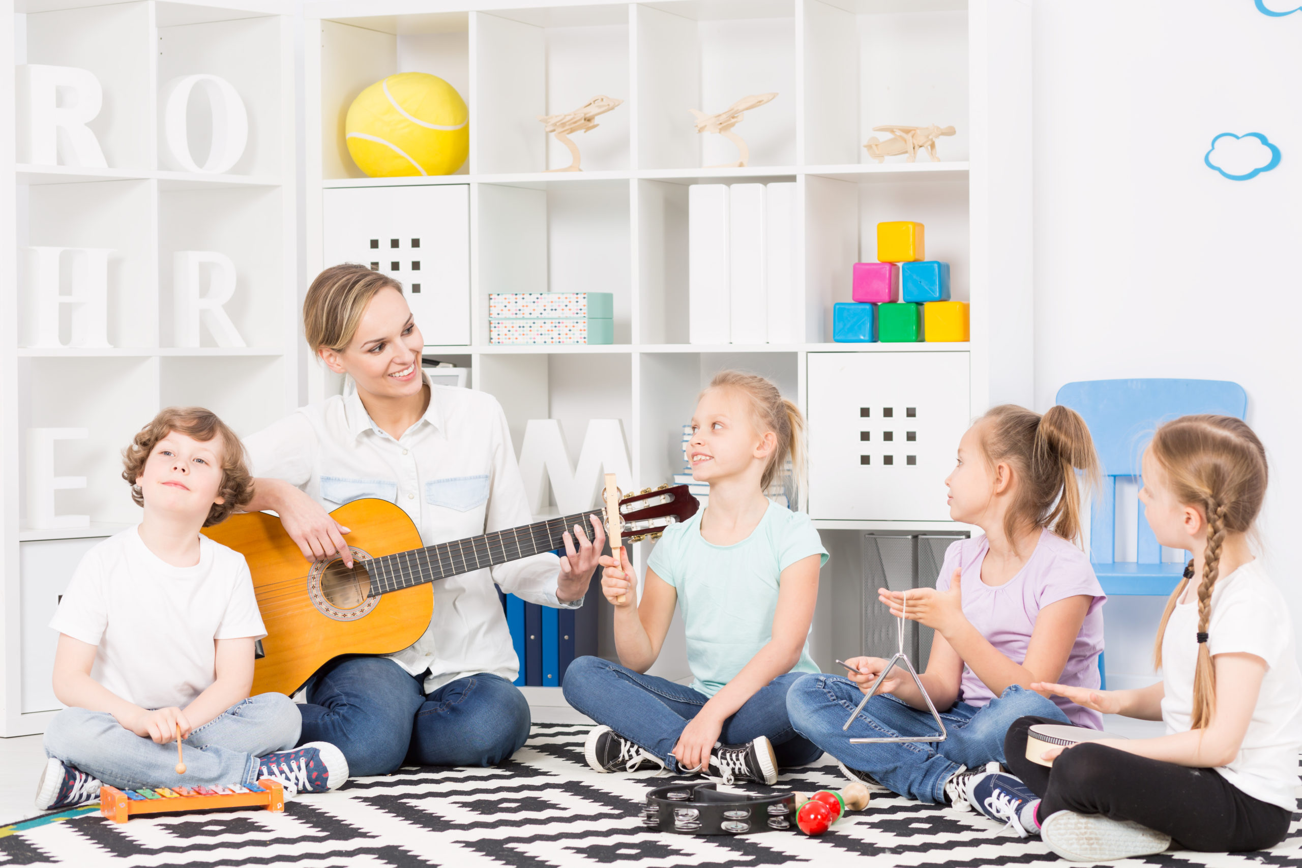 Group,Of,Children,Playing,Different,Musical,Instruments,,Sitting,On,A